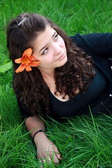 Free Teenager About A Flower Royalty Free Stock Images - 15138889