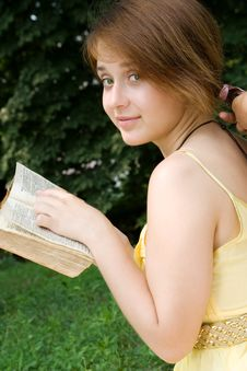 Free Young Girl Studying A Book Outdoors Royalty Free Stock Image - 15139896
