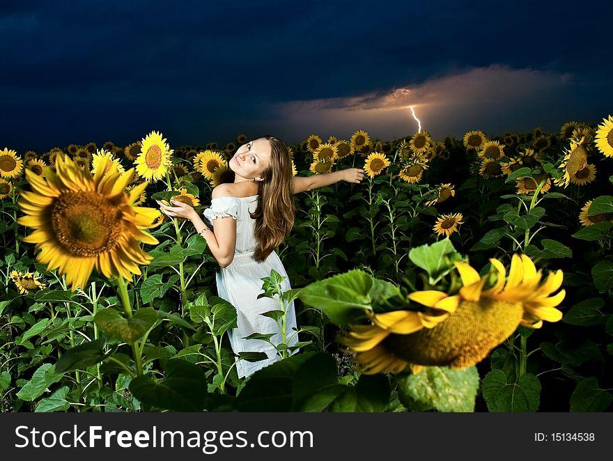 Woman inside sunflowers field