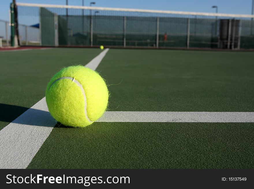 Tennis Balls on the Court