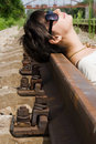 Free Girl Laying On The Railroad Carelessly Stock Photography - 15140062