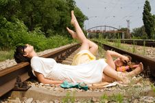 Girls Resting On The Railroad Carelessly Royalty Free Stock Photography