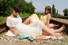 Girls Resting On The Railroad Carelessly Royalty Free Stock Image