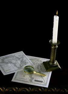 Free A Candle With Old Maps And Magnifying Glass Stock Photo - 15141280