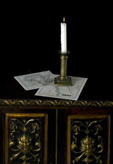 A Candle With Old Maps  In Old Candlestick