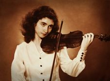 Free Old Photo Of A Girl Playing Violin Royalty Free Stock Image - 15142606