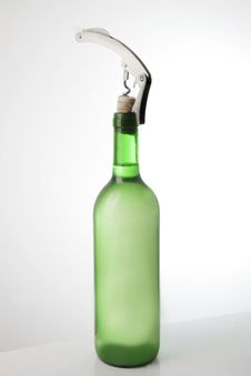 White Wine Bottle And Corkscrew Stock Images
