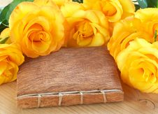 Yellow Roses On A Book Royalty Free Stock Photos