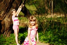Two Smiling Girl In Pink Clothes Royalty Free Stock Image
