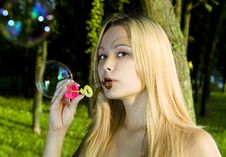 Free Blonde Woman Blowing Soap Bubbles Royalty Free Stock Photo - 15149135