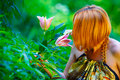 Free Red-haired Girl And Beautiful Lily In The Garden Royalty Free Stock Images - 15158559