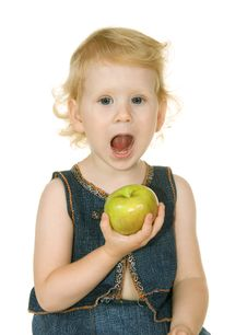 Free Small Girl With Apple Stock Image - 15152441