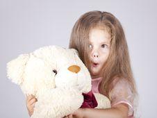 Free Little Shouting Girl Embraces Bear Cub. Stock Photo - 15154590