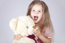 Free Little Shouting Girl Embraces Bear Cub. Royalty Free Stock Images - 15154599