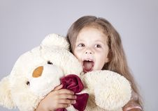 Free Little Shouting Girl Embraces Bear Cub. Stock Photography - 15154602