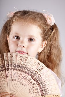 Free Portrait Of Beautiful Young Girl With Fan Stock Photography - 15154672