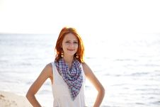 Beautiful Red-haired Girl At Sunrise On The Beach. Royalty Free Stock Photo
