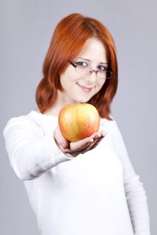 Free Girl With Apple In Hand. Royalty Free Stock Images - 15155169