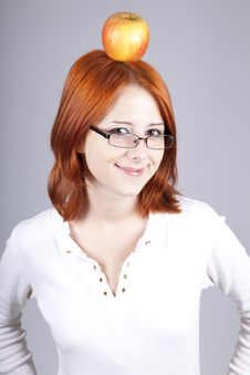 Free Red-haired Girl Keep Apple On Her Head. Royalty Free Stock Image - 15155206