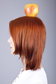 Free Red-haired Girl Keep Apple On Her Head. Royalty Free Stock Images - 15155209