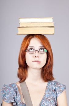 Free Red-haired Girl Keep Books On Her Head. Stock Photo - 15155220