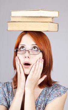 Free Red-haired Girl Keep Books On Her Head. Stock Photo - 15155280