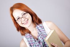 Free Red-haired Girl Keep Book In Hand. Royalty Free Stock Photography - 15155347