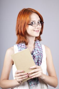 Free Red-haired Girl Keep Book In Hand. Royalty Free Stock Photography - 15155367