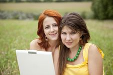 Two Beautiful Girls With Notebook Stock Photo