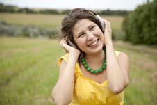 Free Young Smiling Fashion Girl With Headphones Stock Photo - 15155480