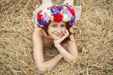 Girl In Slav National Wreath Lying At Field. Royalty Free Stock Photos