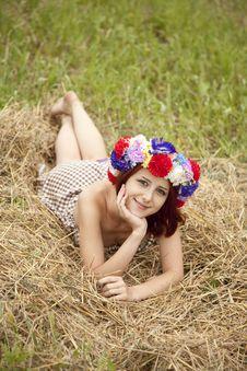 Girl In Slav National Wreath Lying At Field. Stock Photos
