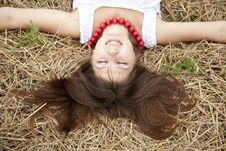 Free Beautiful Girl Lying At Hay Field. Royalty Free Stock Photography - 15155877