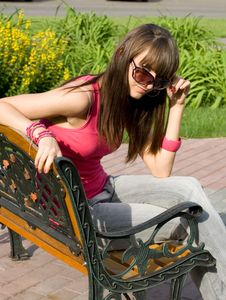 Free Girl Sitting On Bench Stock Images - 15156054