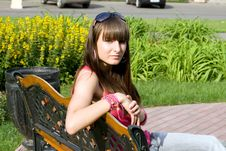 Free Girl Sitting On Bench Stock Images - 15156074