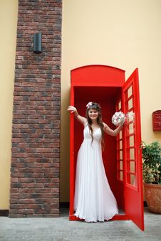 Free Bride In The Telephone Cabin Royalty Free Stock Image - 15156276
