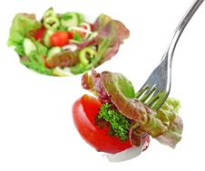 Silver Fork With Vegetable Salad Stock Photos