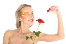 Free Young Woman Tears Off Petals At Flower Stock Images - 15157924