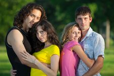 Free Four Young People Embrace And Stand Royalty Free Stock Photo - 15158025