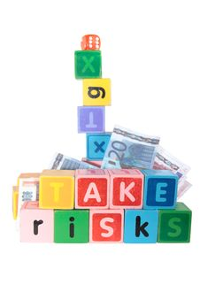 Free Take Risks In Childs Letter Play Blocks Royalty Free Stock Photography - 15158067