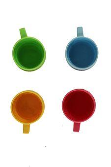 Multi-coloured Tea Cups Stock Image