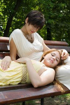 Free Young Girls On The Bench In The Park Royalty Free Stock Photography - 15159867