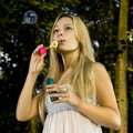 Free Blonde Blowing Soap Bubble Royalty Free Stock Image - 15163136