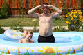 Free Pair Bathes In Inflatable Pool Stock Photos - 15164473