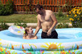 Free Pair Bathes In Inflatable Pool Royalty Free Stock Image - 15164476