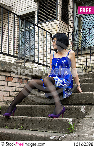 Free Girl On The Stairs Royalty Free Stock Photos - 15162398