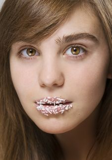 Girl With A Coconut Shaving On Lips Stock Photo