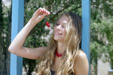 Free Smiling Lady On Swing With Cherry Stock Image - 15160771