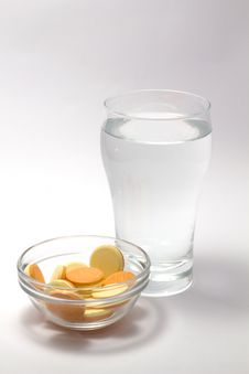 Free Effervescent Tablets And A Glass Of Water Royalty Free Stock Image - 15160866