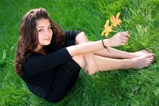 Free Girl The Teenager About A Flower. Stock Photos - 15161453